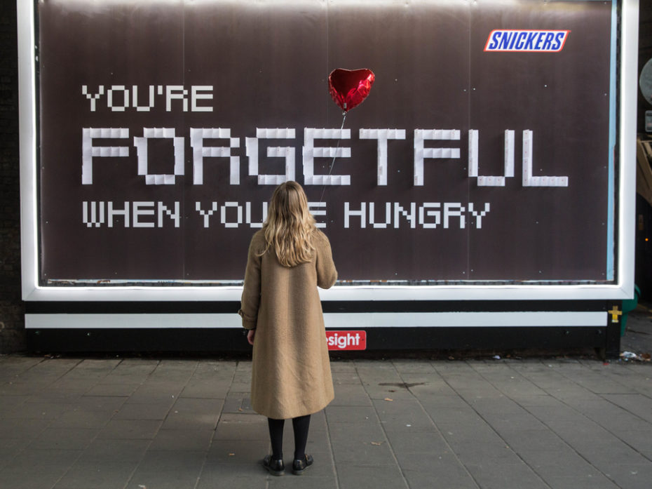 """Jeff Moore  """"THIS PICTURE IS FREE FOR EDITORIAL USE""""  Tuesday 14 February 2017. Commuters at London Waterloo station were thrown a love lifeline this morning as Snickers offered up last minute Valentine's Day cards for forgetful passengers. Over the next three days, the Snickers 'You're Not You When You're Hungry' campaign, will help forgetful Londoners by running a special outdoor poster with the tagline 'You're Forgetful When You're Hungry' with the word 'Forgetful' made out of 3000 Valentine's Day cards that people can peel off and take away to use. Tomorrow (Weds 15th) a second set of 3000 cards will be available for those who missed the big day altogether. These will read 'Sorry I forgot. On the plus side, booking a restaurant should be easier. Happy Belated Valentine's'."""